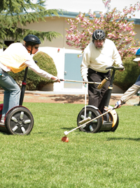 Ginny Prior and Steve Wozniak playing Segway polo